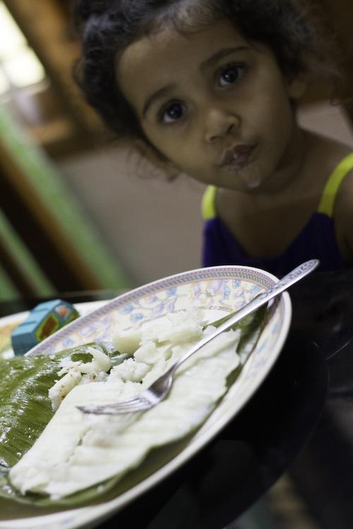 eating breakfast steamed banana leaf appam - kerala