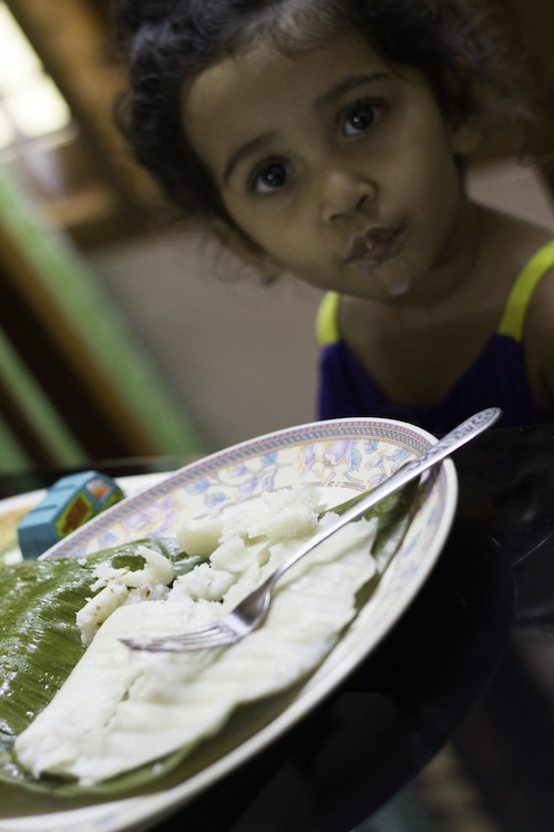 eating breakfast steamed banana leaf appam - kerala